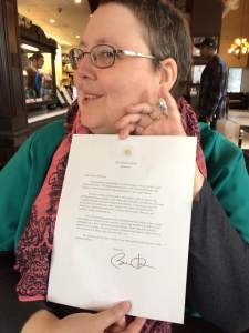 The welcome note with President Obama's signature!